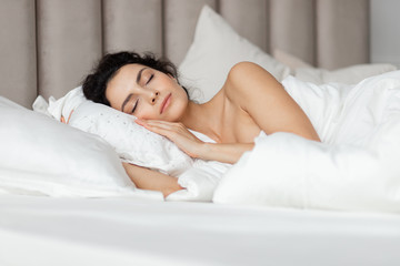 Beautiful  woman having  dreams in white bed