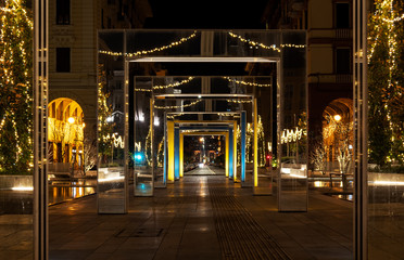 Piazza verdi, the main square in La Spezia, Liguria in Italy with festive Christmas lights at night. No people. Fotomurales