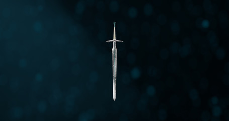 Foto auf Acrylglas Schwarz Witcher sword concept on Classic Blue background with dust particles. 3d rendered scene