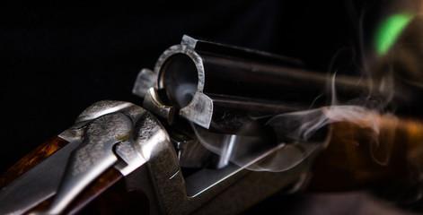 Papiers peints Chasse Smoking hunting gun or shotgun, clay pigeon shooting, Aviemore, Scotland, UK