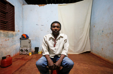Genivaldo Batista dos Santos poses for a picture in his accommodation after working on a coffee farm, in Campos Altos