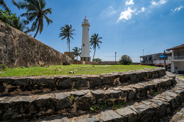 Galle Fort Lighthouse - view with steps leading up to the maritime structure in Sri Lanka