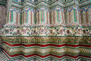 Beautiful intricate details on wall of the Grand Palace ancient buddhist temple in Bangkok Thailand
