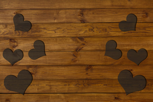 old wood background design Valentine's day background withhearts on wooden planks