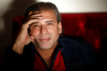 Khaled Youssef, member of the Egyptian parliament and film director, poses for a portrait inside his private appartment in Paris