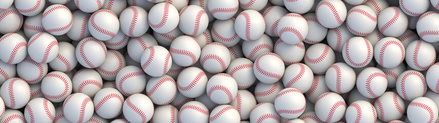 Baseball balls background with red stitching lying in a pile