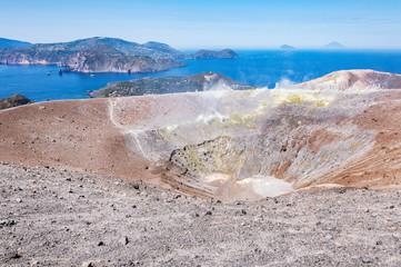 Smoking crater of the volcano. Volcano island. Italy.