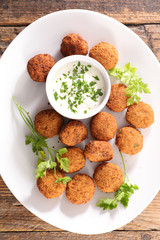 Fototapete - falafel with dipping sauce and herb