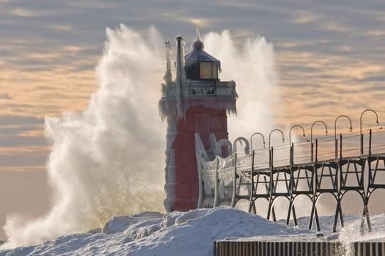 Winter South Haven, Michigan Lighthouse with crashing wave, Lake Michigan, USA