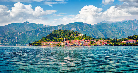Popular tourist destination - Bellagio town, view from ferry boat. Superb morning scene of Como lake, Italy, Europe. Traveling concept background.