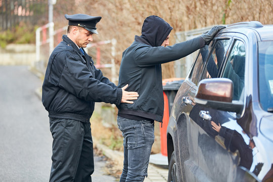 Policeman searching a thief
