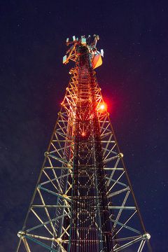 Mobile phone Telecommunication Radio antenna Tower. On the tower, work is underway to replace the antenna from 4g to 5g