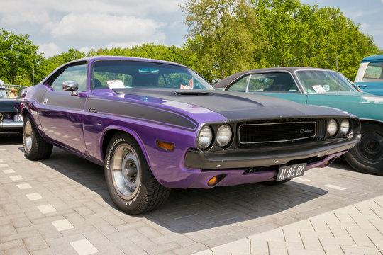 DEN BOSCH, THE NETHERLANDS - MAY 10, 2015: Purple 1970 Dodge Challenger classic car.