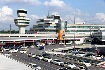 BERLIN - JUN 1, 2016: Airport tower and taxi s in front of the airport terminal of Berlin-Tegel airport.