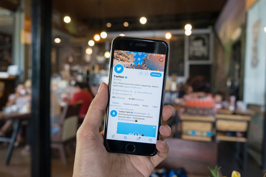 CHIANG MAI, THAILAND - AUG 03, 2017: Man holding a brand new Apple iPhone  with Twitter logo on the screen. Twitter is a social media online service for microblogging and networking communication.