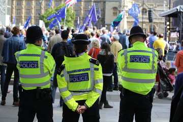 Police observe an anti-Brexit Remain rally at Westminster, UK