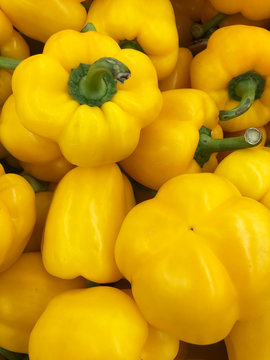 Yellow bell pepper background in the store.