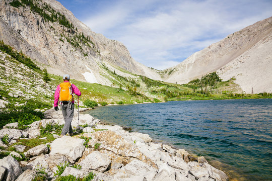 A woman at 'Our Lake', one of the few alpine lakes on the Rocky Mountain Front, Lewis and Clark National Forest, central Montana, USA