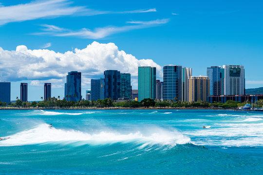 Ala Moana Beach Skyline with Waves and Surfers