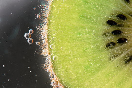 Macro kiwi in bubbly water