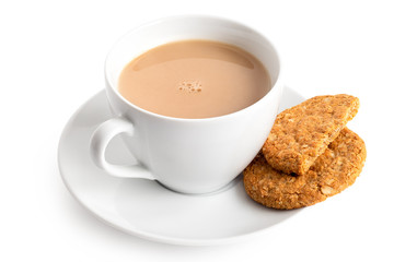 Cup of tea with milk and one and half crunchy oat and wholemeal biscuits isolated on white. White porcelain.