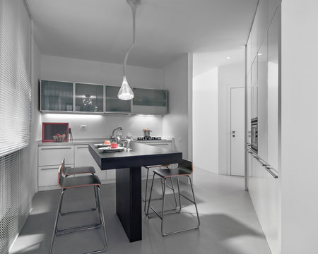 inerior view of a modern kitchen in the foreground the kitchen island the floor is made of resin