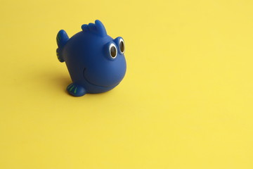 Child's toy for blue fish-shaped bathtub
