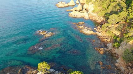 Fototapete - Beautiful tropical seascape from above. Mediterranean coastline with cliffs and turquoise water. Flight over Costa Brava seashore, Spain.