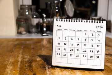 May 2020 calendar - month page on wooden table in the kitchen