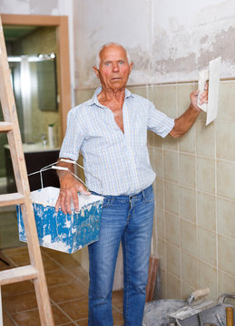 Elderly man with spatula and plaster