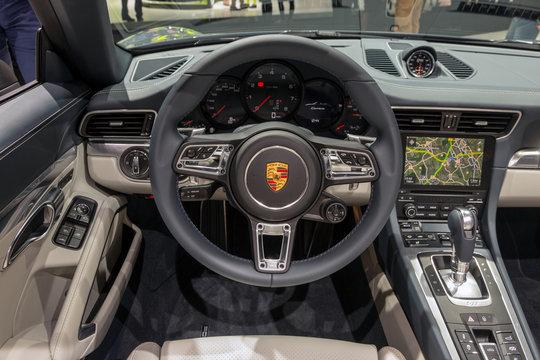 FRANKFURT, GERMANY - SEP 16, 2015: Interior dashboard view Porsche 911 Carrera sports car showcased at the Frankfurt IAA Motor Show.