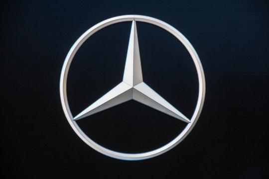 FRANKFURT, GERMANY - SEP 16, 2015: Mercedes Benz logo on the wall of the Frankfurt IAA Motor Show.