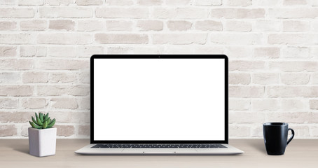 Laptop mockup on simple, clean desk with brick wall in background. Isolated screen for ap, web site...