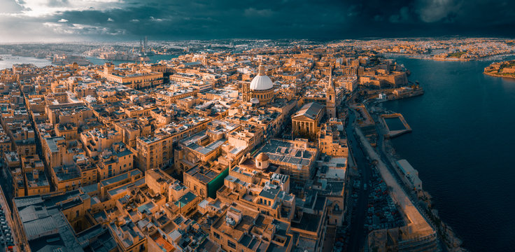 City of Valletta, capital of Malta, aerial view, island in Mediterranean sea, dramatic sky