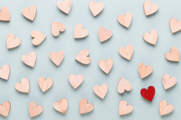 Happy Valentines day background. red hearts on white wooden background.