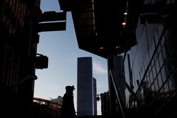 A man is seen in silhouette walking during cold weather in the Manhattan borough of New York City, New York