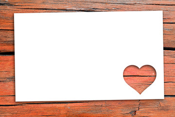 Love Valentine's day background with paper on wood