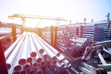 Foto op Plexiglas Metal Metal warehouse outdoor of lighting poles. Storage of metal galvanized faceted pipes with flange.