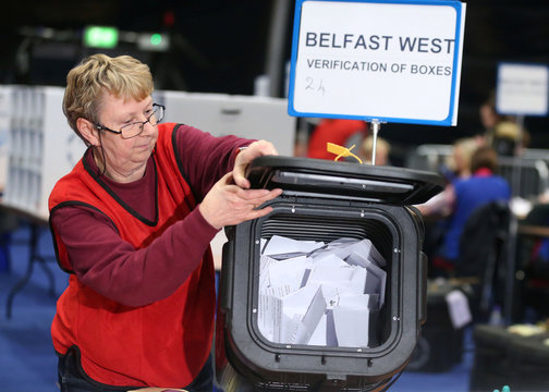 The first ballot boxes are opened at the count centre, Titanic Quarter, Belfast, Northern Ireland
