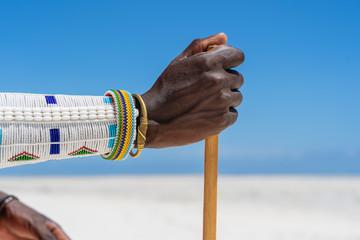 Tribal masai hand with a colorfull bracelet, close up. Zanzibar, Tanzania, Africa