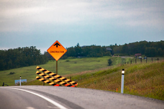 Temporary condition road signs, Construction work ahead with Barriers. on Canadian rural country highway roadside, warning orange symbols