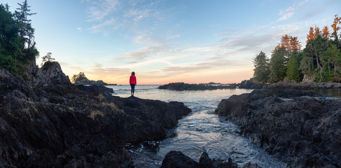 Wall Mural - Wild Pacifc Trail, Ucluelet, Vancouver Island, BC, Canada. Girl Enjoyin the Beautiful View of the Rocky Ocean Coast during a colorful and vibrant morning sunrise.