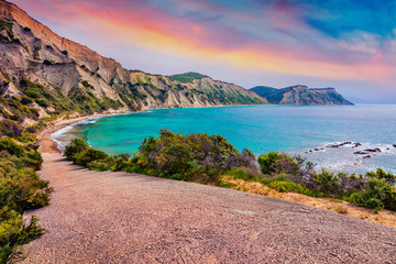 Foto auf Acrylglas Lachs Incredible summer sunrise on Kanoula beach. Captivating morning seascape of Ionian Sea. Unbelievable outdoor scene of Corfu island, Greece, Europe. Beauty of nature concept background.