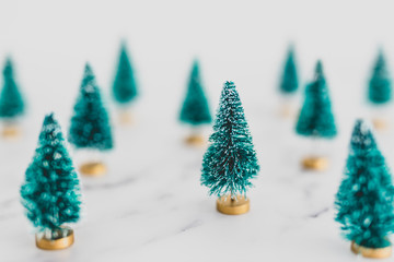 festive season's decorations group of miniature Christmas trees shot at shallow depth of field