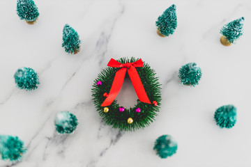 festive season's decorations group of miniature Christmas trees with wreath