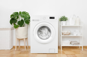 Interior of pastel colors laundry room with modern washing machine Fotomurales