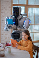 Robot with a tablet in his hands making pictures