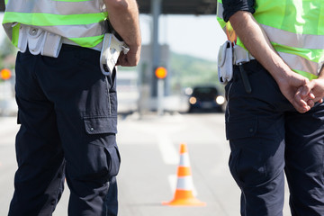 Police officers controlling traffic on the highway