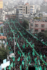 Palestinians take part in a rally marking the 32nd anniversary of Hamas founding in the northern Gaza Strip