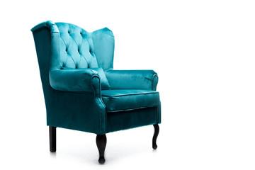 Fototapeta elegant velour blue armchair with pillow isolated on white obraz